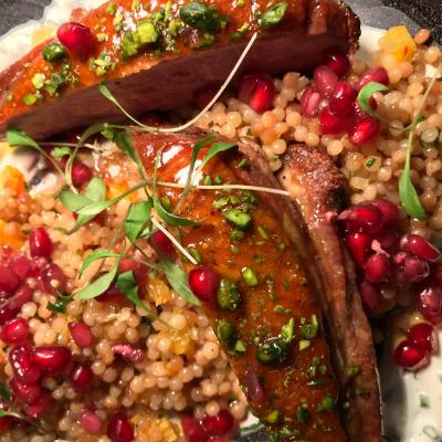 Honey Glazed Duck Breast Pistachios Smoked Cous Cous Creme Fraiche Pomegranate